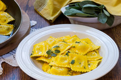 Homemade ravioli pasta with sage butter sauce , italian food Royalty Free Stock Photo