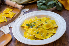 Homemade ravioli pasta with sage butter sauce , italian food Royalty Free Stock Images