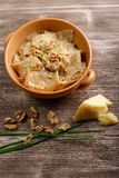 Homemade ravioli pasta with walnut, cheese and herb sauce Royalty Free Stock Images