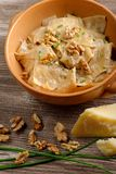 Homemade ravioli pasta with walnut, cheese and herb sauce Stock Photography