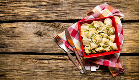 Homemade ravioli is prepared in a cup. On wooden background. Homemade ravioli is prepared in a cup. On the wooden background. Free space for text . Top view Royalty Free Stock Photos