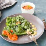 Homemade ravioli with shrimp and spinach. And marinara sauce Stock Photos