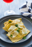 Homemade ravioli with spinach and ricotta cheese with grated parmesan Royalty Free Stock Photo