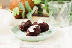 Homemade raw bounty candy, healthy vegan dessert. Coconut in chocolate.Detox diet food concept Stock Image