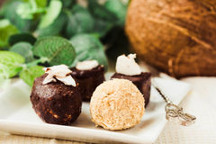 Homemade raw chocolate candy, bounty, Raffaello.Healthy vegan d. Homemade raw chocolate candy, bounty, Raffaello. Healthy vegan dessert.Healthy lifestyle and raw stock photography