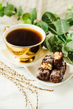 Homemade raw chocolate candy. Snickers bars with cup of coffee. Stock Images