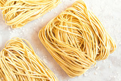Homemade Raw Egg Noodles. On a white background close up Stock Photo