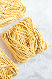 Homemade Raw Egg Noodles. On a white background close up Royalty Free Stock Photography