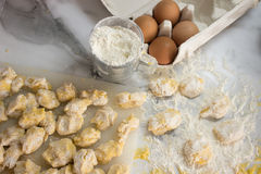 Homemade raw gnocchi. Raw homemade and handmade italian gnocchi with flour and eggs on a table Royalty Free Stock Image