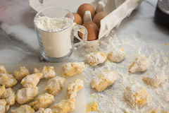 Homemade raw gnocchi. Raw homemade and handmade italian gnocchi with flour and eggs on a table Royalty Free Stock Photo