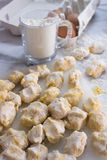 Homemade raw gnocchi. Raw homemade and handmade italian gnocchi with flour and eggs on a table Stock Images