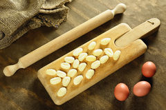 Homemade raw gnocchi, italian fresh pasta. Homemade raw gnocchi on a wooden chopping board, italian fresh pasta Stock Photography