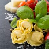 Homemade raw Italian tortellini with ham and cheese Stock Photos