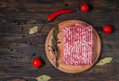 Homemade raw minced meat with herbs closeup, top view Stock Image