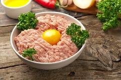 Homemade raw minced pork with egg yolk Royalty Free Stock Photos