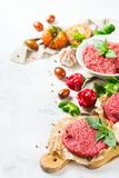 Homemade raw organic minced beef meat burger cutlet and vegetables. Healthy food, cooking concept. Homemade raw organic minced beef meat and burger steak cutlet stock image