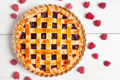 Homemade raw raspberry pie greased with egg yolk Royalty Free Stock Image