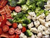 Homemade Raw Roast vegetables with tomatoes, peppers, mushrooms,broccoli ,cauliflower cabbage and spices royalty free stock photos
