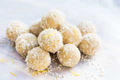 Homemade Raw Vegan Coconut and Lemon Truffles. On White Background royalty free stock photography