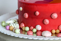Homemade red birthday cake with air baloons.  royalty free stock photo