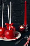 Homemade red caramel coating apples on a sticks for Christmas and New Year Stock Image