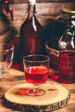 Homemade red currant liquor. In a drinking glass royalty free stock photos
