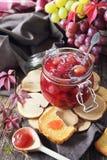 Homemade red grapes jam in jar and grape berries Stock Photo