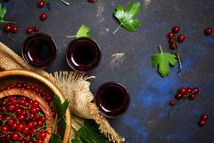 Homemade redcurrant liqueur, top view stock photography