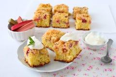 Rhubarb cake. Homemade rhubarb cake with crumble and whipped cream stock images