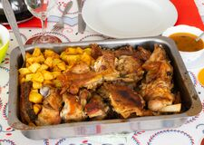 Homemade roasted goatling/roasted kid `cabrito assado` with potatoes ready to eat. It is a traditional portuguese dish.