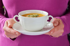 Homemade roasted-pumpkin soup in a white bowl. Stock Photo