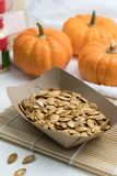 Roasted spicy pumpkin seeds with cumin and brown sugar stock photos