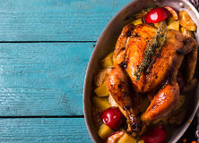 Homemade Roasted Thanksgiving Day Turkey on bright blue wooden background. Style rustic. Top view. Space for text Royalty Free Stock Image