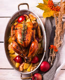 Homemade Roasted Thanksgiving Day Turkey on white wooden background. royalty free stock photo