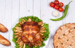 Homemade  roasted whole turkey on wooden table for Thanksgiving. Royalty Free Stock Image