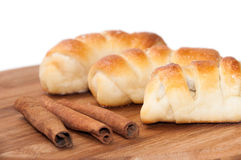 Homemade rolls with cream and powdered sugar and cinnamon sticks Royalty Free Stock Photo