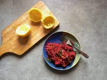 Homemade root vegetable slaw with beets, carrots, celeriac, parsley, lemon Stock Photo
