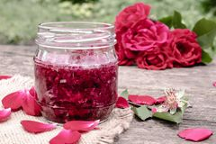 Homemade rose petal jam. Flower confiture. Healthy food. Copy space royalty free stock photography