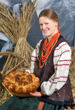Homemade round bread in hands of girl Stock Photography