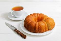Homemade round lemon cake soaked with lemon syrup stock photo
