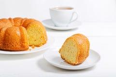 Homemade round lemon cake soaked with lemon syrup royalty free stock image