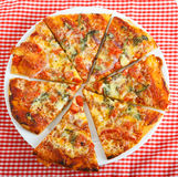 Homemade round pizza on plate Royalty Free Stock Photos