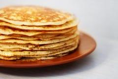 Homemade russian pancake on white background. Homemade pancakes in a clay plate on a white background russian traditional blini breakfast food crepe maslenitsa stock photos