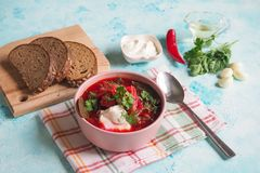 Homemade Russian, Ukrainian and Polish national soup - red borscht made of beetrot, vegetables and meat with sour cream. Homemade Russian, Ukrainian and Polish Stock Photo