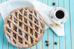 Homemade rustic apple tart pie on dish over wooden turquoise background Stock Image
