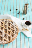 Homemade rustic apple tart pie on dish over wooden turquoise background Royalty Free Stock Image