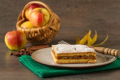Home baked apple cake on rustic autumn table. Homemade rustic autumn apple cake on a table Stock Photos