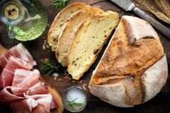 Homemade rustic bread loaf with ham Stock Photography