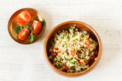 Homemade rustic bulgur salad. Delicious homemade vegetarian bulgur dish with vegetables and fresh herbs Stock Photo