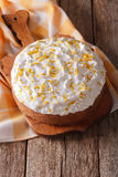 Homemade rustic cake with white icing closeup. Vertical Royalty Free Stock Images